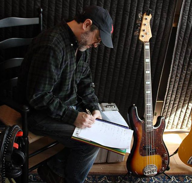 Jon in studio taking notes. Photo: FJ Ventre.