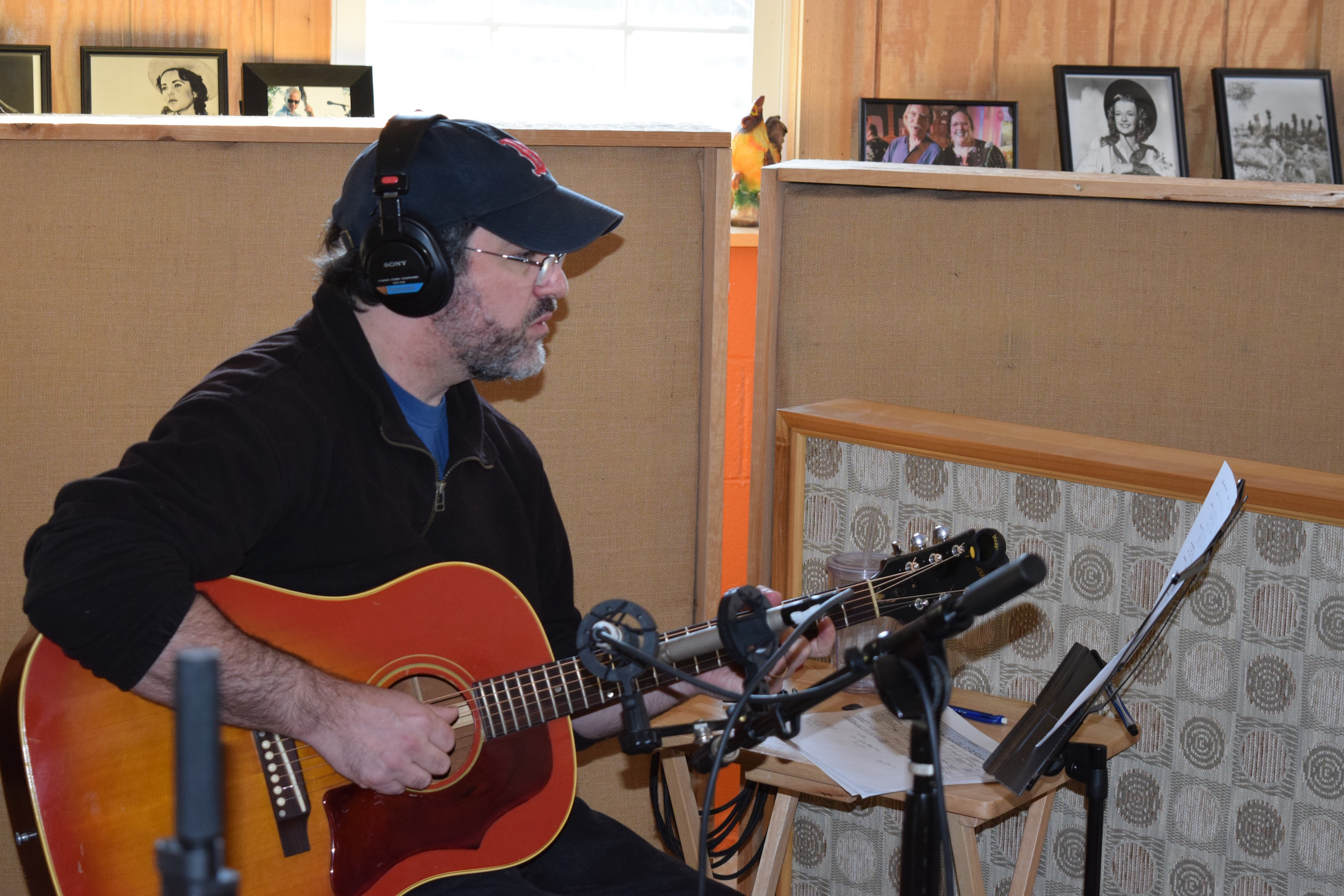 Jon Shain playing guitar in studio